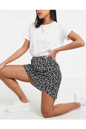 ASOS Mini bias slip skirt in mono floral print
