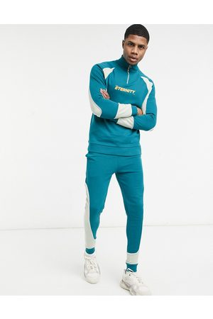 ASOS Hombre Conjuntos de deporte - Tracksuit with half zip in colour block panels & chest print