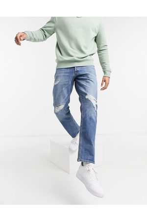Jack & Jones Intelligence Chris loose fit jeans with rips in blue