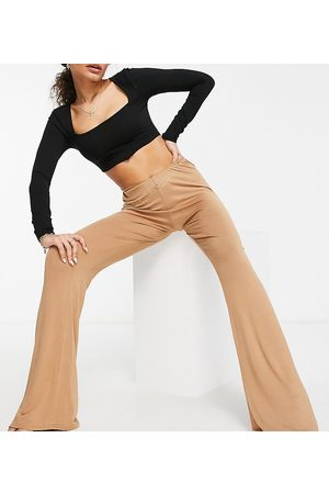 Fashionkilla Kick flare trousers with hip strap in camel