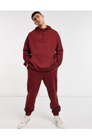 ASOS Organic tracksuit with oversized hoodie & oversized joggers in burgundy