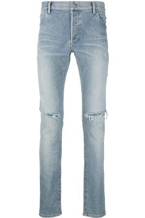 Balmain Jeans slim con detalles rasgados