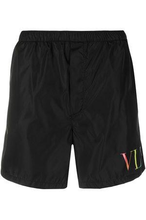 VALENTINO Shorts de playa con estampado VLTN