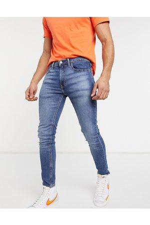Levi's Levi's Youth 519 super skinny fit hi ball jeans in goth semi pro advance mid wash