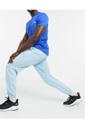 ASOS Icon tapered training joggers in blue