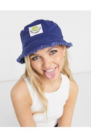 ASOS Canvas bucket hat with happy face label in navy