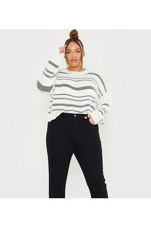 In The Style X Lorna Luxe skinny denim jean with stirrup detail in black
