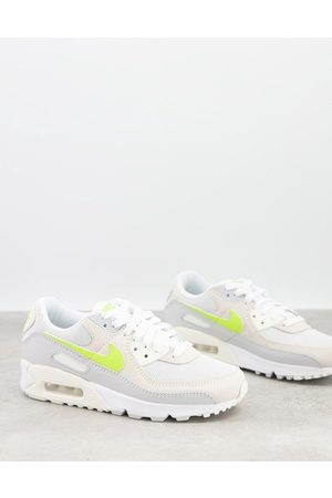 Nike Air Max 90 trainers in white and lemon pastel