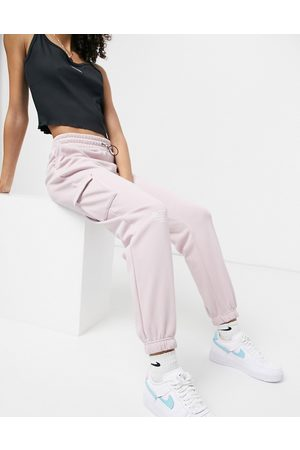 Nike Swoosh fleece joggers in light pink