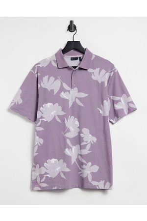 ASOS Relaxed short sleeve polo shirt in purple with all over floral print