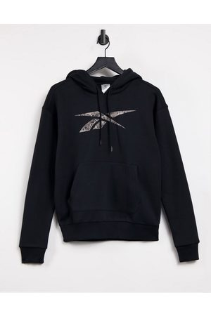 Reebok Training hoodie in black with leopard logo