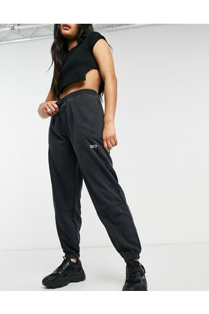 Night Addict Mujer Leggings y treggings - Oversized joggers with print