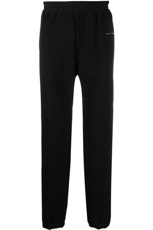 1017 ALYX 9SM Hombre Pantalones y Leggings - Pants con franjas a los lados