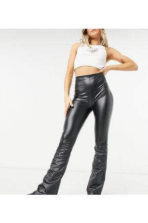 COLLUSION Coated legging flares in black