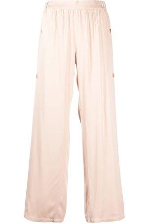 AERON Pantalones con botones laterales