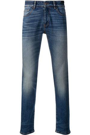 PT05 Skinny jeans con efecto desgastado