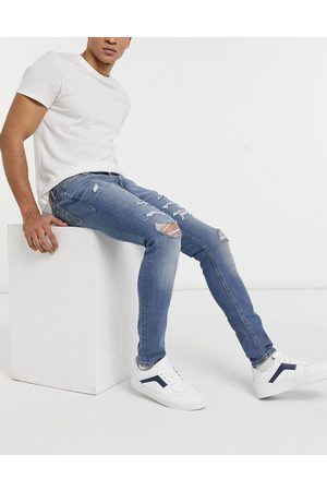 Jack & Jones Intelligence Liam skinny jeans with rips in blue