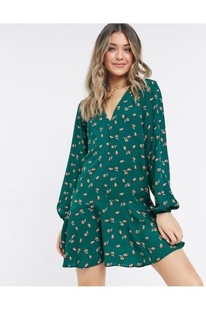 ASOS Long sleeve v neck mini dress with curved hem in green floral