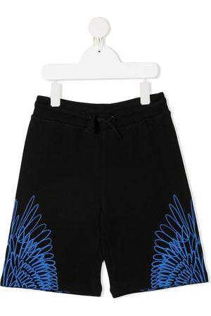 MARCELO BURLON Shorts deportivos con estampado Wings