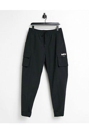 Mennace Crinkle tech tracksuit cargo trousers in black