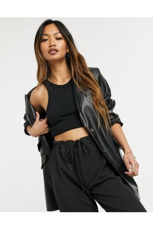 ASOS Leather look strong shoulder nipped waist longline blazer in black