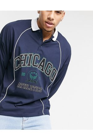 ASOS Oversized long sleeve polo shirt in navy with city print