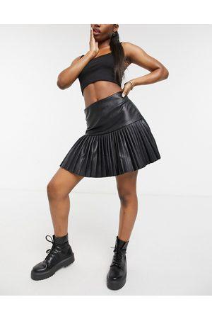 Femme Luxe Pu pleated skater skirt in black