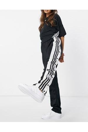 adidas Adibreak side popper track pants in black