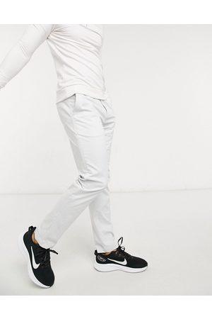 Nike Dry slim chino trousers in light grey