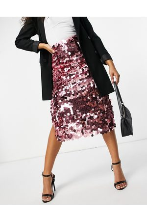 Never Fully Dressed Disc sequin midi skirt in pink