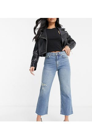 ASOS ASOS DESIGN Petite high rise stretch 'effortless' crop kick flare jeans in midwash with thigh rip