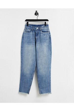 The Couture Club High waisted mom jeans with rips in light wash blue