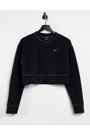 Nike Icon Clash sweatshirt in black and gold