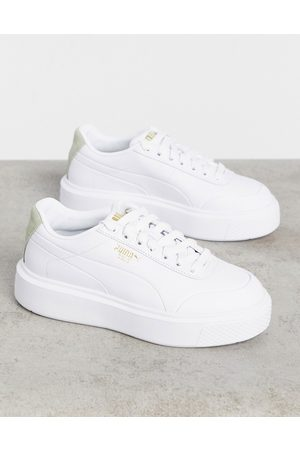 PUMA Oslo Femme trainers in white and sage