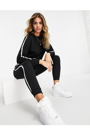 ASOS Tracksuit sweat / basic jogger with contrast binding in organic cotton in black