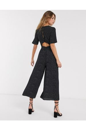 ASOS Tea jumpsuit with button back detail in mono spot