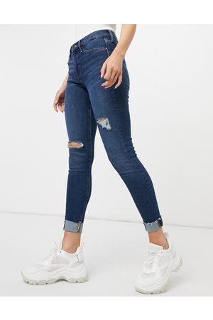 River Island Molly ripped raw hem skinny jeans in dark auth blue