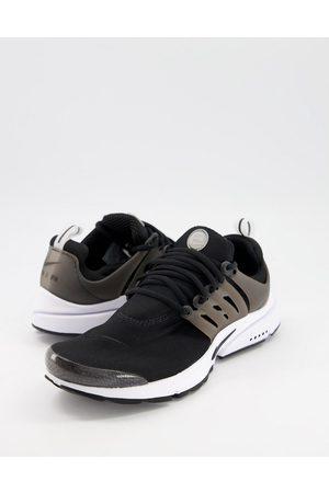 Nike Air Presto trainers in black/white