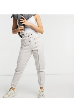 River Island Seam detail joggers in mink pink