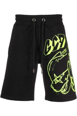 GCDS Shorts deportivos con estampado de grafiti