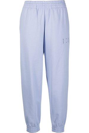McQ Pantalones de chándal con estampado gráfico