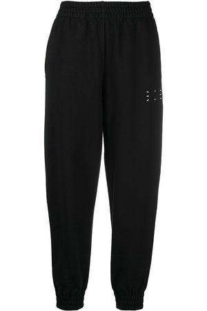 McQ Mujer Pantalones y Leggings - Pantalones de chándal con estampado gráfico