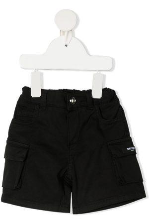 Balmain De mezclilla - Shorts de mezclilla cargo con bolsillos