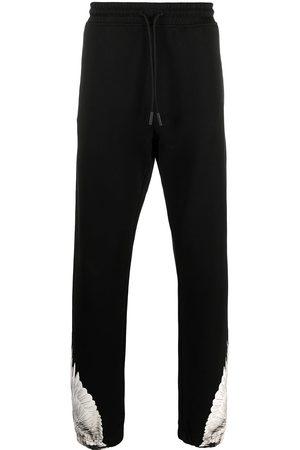MARCELO BURLON Pants con motivo Wings