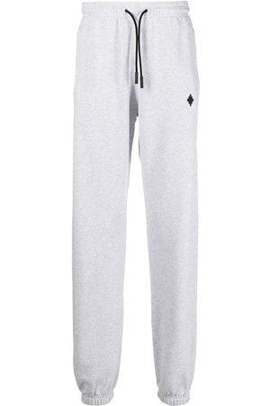 MARCELO BURLON Hombre Pantalones y Leggings - Pants con logo bordado