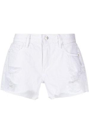 Frame Shorts de mezclilla con detalles rasgados