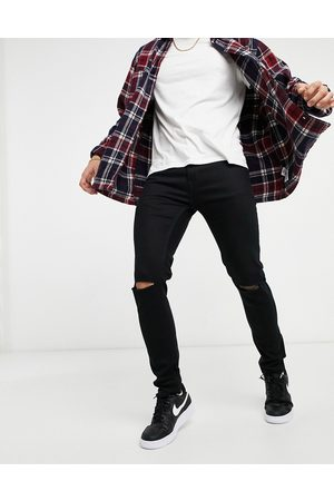 Topman Skinny jeans with double knee rip in black