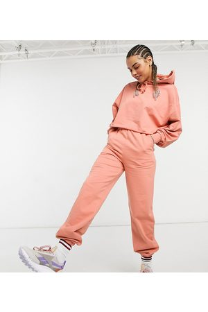 COLLUSION Oversized embroidered joggers in peach co