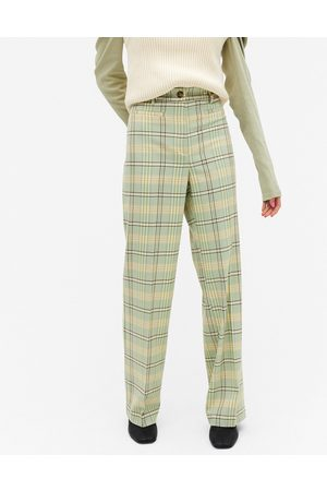 Monki Stacy check flare trousers in green