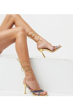 Public Desire Super heeled sandals with multi coloured straps in gold